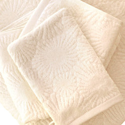 "Hexogonaria Hand Towel - White Sand 16"" x 30"" - Hexagonaria Percarinata, or Petoskey stone, is a fossilized 350 million-year-old coral named after Ottawa Indian Chief Ignatius Petosega, whose name poetically means �rising sun� or �rays of dawn.�  These ultra plush bath towels and mits are crafted from 100% organic cotton in a beautiful White Sand hue and exude an opulent feel. Place them thoughtfully in a basket for use in a guest bathroom, or use them everyday and bask in the luxuriousness of Affina."
