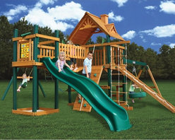 Gorilla Playsets - Gorilla Playsets Blue Ridge Pioneer Peak Wood Swing Set - 01-0006 - Shop for Swings Slides and Gyms from Hayneedle.com! Additional featuresTongue and groove A-frame wood roof2 swings and 1 trapeze barSolid 4 x 4-in. and 4 x 6-in. main beams Maintenance-free vinyl-coated preserved pine structural beamsChoice grade factory-stained woodTongue and groove wood roof5-ft. H deckTire swing and swivelDeluxe climbing ramp with knotted rope3-position swing beam2 swings with powder-coated chains1 trapeze bar with powder-coated chainsIron ductile swing hangersClimbing rope ladderBuilt-in picnic tableRock wall with climbing ropeClatterbridge and towerExclusive Tic-Tac-Toe spinner panel 10-year warranty on Gorilla Playsets frame1-year warranty on Gorilla Playsets accessories The Gorilla Playsets Blue Ridge Pioneer Peak Wood Swing Set combines an abundance of play features with outstanding craftsmanship and resilient materials. This swing set is constructed from factory-stained and sealed pine including vinyl-coated preserved pine structural beams all of which are resistant to rot decay and insect damage. These beams are held together securely with galvanized countersunk bolts to resist weather and provide an added element of safety. A 4x6-foot clubhouse play deck features a tongue and groove A-frame wood roof overhead to provide shelter and shade. There's even a clatterbridge with guard rails that leads to a separate lookout tower where your kids can play on the Tic-Tac-Toe spinner panel. Below the clubhouse a built-in picnic table provides the ideal place for lunches and snacks.About Gorilla Playsets Since 1992 Gorilla Playsets has been designing and selling ready-to-assemble playsets. With a reputation for providing excellent customer service Gorilla Playsets conveniently provides customers with affordable playsets including quality wood components sturdy playset accessories all necessary hardware and clear instructions. Gorilla Playsets always keeps safety in