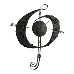 Zeckos - Metal Treble Clef Music Wall Clock Industrial Sculpture - This wall clock is full of industrial elements making beautiful music with time. Featuring a distressed finish, it's constructed from metal pieces, including nuts and bolts to create this truly unique wall clock. Based on the silhouette of a treble clef, it looks amazing on any wall in your home, office, restaurant or shop It requires only one AA battery (not included), measures 24 inches (61 cm) high, 20 inches (51 cm) wide, 1.5 inches (4 cm) deep, and easily hangs using the attached hanger on the back. It's a great time piece to show your love of music and art