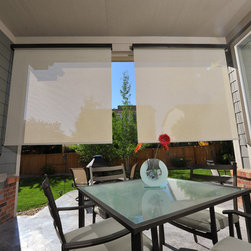 Exterior Solar Screen Shades or Porch Shades - Two patio shades that have been installed on the inside of the patio. This is our Maui color and it provides 72% UV protection
