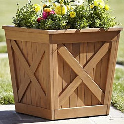 "Hampstead Teak Square Planter - With the distinctive features of our Hampstead Collection - the X-design, slatted wood and a warm, natural finish - this planter is made of premium teak for year-round use. Click to read an article on {{link path='pages/popups/hampstead-care_popup.html' class='popup' width='640' height='700'}}recommended care{{/link}}. 24"" square, 24.5"" high Built from teak, a dense hardwood that's ideal for outdoor use. Finished by hand with a light natural finish that protects and seals the wood. Includes a removable aluminum liner. View our {{link path='pages/popups/fb-outdoor.html' class='popup' width='480' height='300'}}Furniture Brochure{{/link}}."