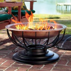 Solid Hammered Copper Fire Pit With Lid - A fire pit is a nice addition to a patio space. This hammered copper one has a lid that converts to a table. Use it as a table for an outdoor lunch and then build a fire in the evening for those fireside chats with friends and family.