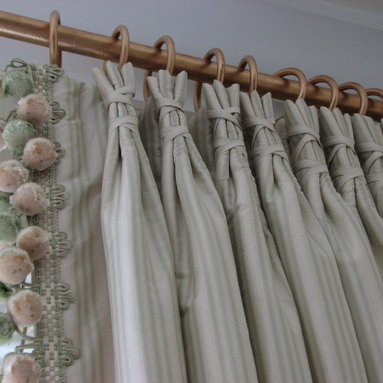 Custom Draperies - This photo shows a rather unusual looking style of pinch pleating, The pleats are wrapped with a shoe lace type matching fabric tie around pleat.