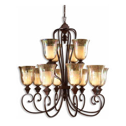 Uttermost - Elba 12-Light Candle Chandelier - Take a step back in time with this grand, 12-light chandelier. No crystals here ... just iridescent, crackled glass globes sitting on curved arms of wrought metal. Inside are columns of glass that look like pillar candles, but actually hold chandelier bulbs. Empress Josephine would feel right at home.