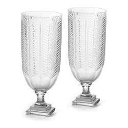 Pair of Fancy Hurricanes - This stunning pair of Fancy Hurricanes look extremely stylish and elegant when comes in use. Belonging to French country chic collection, it has given cut finish to give it more antique look. These heavy cut glass Hurricanes have a nice height and have sturdy square base for firm standing.