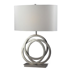 Dimond Lighting - Trinity 1-light Polished Nickel Table Lamp - A series of interlocking rings creates the unique base of this Trinity table lamp,finished in polished nickel.