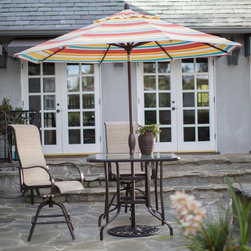 Treasure Garden - Treasure Garden 9 ft. Fashion Auto Tilt Patio Umbrella - UM8100-4889 - Shop for Patio Umbrellas from Hayneedle.com! The fade-resistant Treasure Garden 9 ft. Fashion Auto Tilt Patio Umbrella is just what you need to stand up against the summer heat. This oversized umbrella provides plenty of shade for you and your party and the durable polyester fabric comes in a wide variety of color options to match your personal style. In addition to being undeniably attractive this umbrella also offers plenty of functionality with its automatic tilt operation that makes it easy to block out the sun at any time of day plus a single wind vent that allows heat and wind to escape for added stability and comfort. The Obravia 100% solution-dyed fabric is guaranteed for four years against fading.About Treasure GardenWith locations in Baldwin Park CA in the U.S.A. and in Ningbo China Treasure Garden has evolved into the largest shade products manufacturer in the world. As a small business in 1984 Treasure Garden built a strong foundation of attributes focusing on innovation quality and value. Today Treasure Garden still emphasizes those principles that determined the domestic and international success of the company.