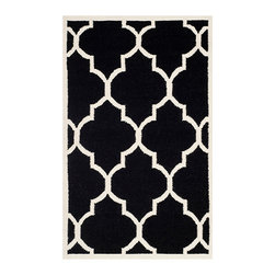 Safavieh - Dhurries Black and Ivory Rectangular: 5 Ft. x 8 Ft. Rug - - This distinctive piece is both stylish and incredibly soft to the touch with bold rich colors that complement any room. Flat-woven by hand in India  - Pile Height: 0.25  - Construction: Flatweave  - Shedding is a normal occurrence and will reduce over time with frequent vacuuming. It is also recommended that you vacuum regularly to prevent dust and crumbs from settling into the roots of the fibers. AVOID DIRECT AND CONTINUOUS EXPOSURE TO SUNLIGHT. USE RUG PROTECTORS UNDER THE LEGS OF HEAVY FURNITURE TO AVOID FLATTENING PILES. DO NOT PULL LOOSE ENDS, CLIP THEM WITH SCISSORS TO REMOVE. TURN CARPET OCCASIONALLY TO EQUALIZE WEAR. REMOVE SPILLS IMMEDIATELY ; IF LIQUID, BLOT WITH CLEAN, UNDYED CLOTH BY PRESSING FIRMLY AROUND THE SPILL TO ABSORB AS MUCH AS POSSIBLE. FOR HARD TO REMOVE STAINS, PROFESSIONAL RUG CLEANING IS RECOMMENDED. STORE IN A DRY, WELL-VENTILATED AREA. USE OF A RUG PAD IS RECOMMENDED. Safavieh - DHU632A-5