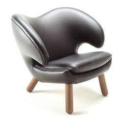IFN Modern - Pelican Style Chair - Its been 71 years since Finn Juhl designed the Pelican chair and still by todays standard it is still a true masterpiece. Its graceful curves that befriend the body and wrap the sitter in its embrace this chair is truly a comfortable chair to sit in for long periods of time. The upholstery is hand sewn onto the frame, and it comes available in multiple different colors of fabric, and leather grades. This reproduction Pelican chair will be a great item to your modern furniture collection and goes well in any dcor. Comes in 100% Cashmere WoolComes in 100% Full Grain Italian Leather, & 100% Full Grain Aniline LeatherAvailable in multiple different colorsWooden legs comes available in - Maple, Walnut, Teak, or OakHigh density foam inside32 D x 31.5 W x 27 HTYPES OF LEATHER:100% Full Grain Italian Leather: Italian leather is often considered to be the best kind of leather in the world. True Italian leather is a type of full-grain that has been hand-selected and hand-crafted. It is a superior quality hide greatly coveted by top furniture manufacturers. Because most Italian leather is of such high quality, it can stay in beautiful condition much longer than other types of leather.100% Full Grain European Aniline Leather: The most attractive and natural leathers which are prized for their soft natural feel. These are leathers which have been aniline dyed in a vat process with no color coating added to the surface. These transparent dyes leave the actual surface grain and such natural markings as wrinkles, bites and scars visible. Because they don't have a top coating the leather breathes more easily and is cooler to sit on. They are the most expensive leathers to produce because only the very best selection of hides can be used to produce full aniline leathers.