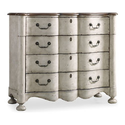 Hooker Furniture - Shaped Front Chest - Everything old is new again with this vintage-inspired dresser. The distressed finish adds character to its shapely facade and lends a neutral look to any room decor.