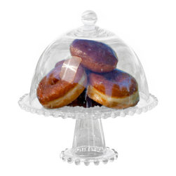 Dome Pedestal Cake Stand - Give your sweets the proper home with this Dome Pedestal Cake Stand. Donuts, cupcakes, and cookies rest easy here until they are ready for you to serve!