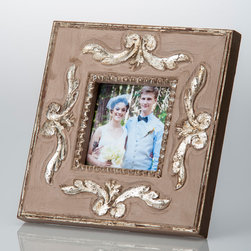 Provence Silver Ribbons Frame - 4 X 4 - Beautiful antiqued silver scrolls adorn the broad Provence Silver Ribbons Frame, a romantic addition to the home with a graceful, traditional appearance and a lovely soft patina.  A high rim and beaded inner border give definition with their metallic subtlety raised above the natural tone of the wood within, bringing the square frame delightfully antiquated depth in its serene motif.