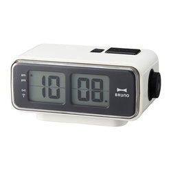 IDEA International - Retro Digital Flip Clock Small - White - The timeless flip clock made DIGITAL! This compact alarm clock is perfect for any nightstand and illuminates with the push of a button. The battery powered clock comes in three different colorways, all have a sense of nostalgia. Fully digital, the changing of the time mimics an old flip clock.