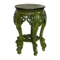 "Pre-owned Small Green Stained Teak Side Table - This Brilliant Imports handmade teak table features gorgeously carved exotic swirls, adding whims and flourish to any room. The small size allows it to fill awkward corners and other small spaces and the deep forest green stain will breathe some life into your space.     From the seller, ""This table is marked down 50% due to cracking (can be fixed with wood glue) picked up while en route from Bali.  Many of our clients simply face the 'blemish' to the wall/corner and no one notices!""    Please contact support@chairish.com if you are interested in purchasing more than one.     DIMENSIONS:  18h x 11.25diam (top), 13""diam (widest point)"
