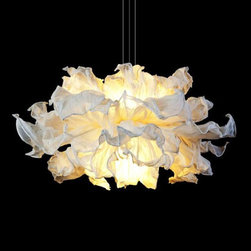 Hive - Fandango Suspension - Fandango hanging lamp is theatrical in expression, dancing in mid-air with similar drama to a girl waving her dress. Several layers of petals made from muslin cotton cloth can be shaped and adjusted to desired wave. The piped-edge, yet flowing feel gives a luxe touch. Available in small or large size option. Two 50 watt 120 volt JCD G9 base halogen bulbs are required, but not included. Small: 29.5 inch width x 15.75 inch height. Large: 39.4 inch width x 25.6 inch height. UL listed.