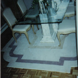 Design Corner Border rug - Borders don't always need to be straight and linear.  Borders on this rug were designed from the table base