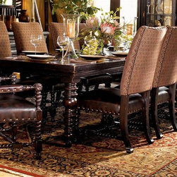 Tommy Bahama Home - 11 Pc Pembroke Dining Set - False Includes dining table, two arm chairs and eight side chairs. Bottom of apron to floor 25.5 in.. Two 24 in. leaves. Extends another 48 in.. Leather upholstered chair. Chairs in hand-rubbed antique brown finish. Nail head decorative trims. Made from mahogany solids, American maple and mahogany veneers. Tamarind - black, highly distressed finish. Minimal assembly required. Table: 72 in. L x 44 in. W x 30.25 in. H (220 lbs.). Arm Chair: 25.25 in. L x 27.5 in. W x 44.5 in. H (45 lbs.). Side Chair: 22 in. L x 27.5 in. W x 44.5 in. H (38 lbs.). Special Care Instructions from Lexington FurnitureKingstown is a relaxed traditional collection inspired by British Colonial style, with a hint of Campaign and a touch of safari. The Tamarind finish is a rich aged black with rub-through to crimson and gold undertones beneath. The evocative designs provide a sense of a well-traveled life.of items hand selected during journeys around the globe. Each piece is crafted as a one-of-a-kind find yet the eclectic collection coordinates beautifully. Travel the world without ever leaving home.