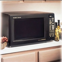 """Sharp - R930AK Countertop Convection Microwave in Black - Features: -1.5 cu. ft., 900 Watts -15 3/8"""" diameter turntable -4-way convection system -Smart & Easy Sensor -CompuBroil, CompuRoast, CompuBake -Temperature control: 100, 150, 275 - 450F in 25 increments -7-Digit, 2-Color Interactive Display -11 variable power levels -Reheat sensor -Popcorn sensor -Built-in applications -Stainless steel interior -Interior light -High and low racks included -AC line voltage: 120V, Single Phase, 60Hz, AC Only -AC power required: 1.55kW, 13.0A -Interior dimensions: 9.625""""H x 16.125""""W x 16.125""""D -Exterior dimensions: 14.875""""H x 24.625""""W x 19""""D This microwave incorporates Sharp's advanced Interactive Cooking System with Custom Help key for easy-to-follow cooking and programming instructions. It has a 4-way convection system that browns, bakes, broils and crisps. Available in Black, White or Stainless Steel. This model can be built into a cabinet or wall by itself or above any electric wall oven or warming drawer using the appropriate Sharp built-in kit."""