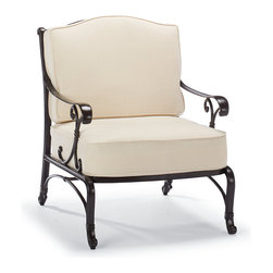 Frontgate - Orleans Outdoor Lounge Chair with Cushions - Solid cast 100% ingot aluminum frame, a premium quality material. Hand-filed welds. Rust-resistant powdercoated frame with UV protected top coat. All-weather chocolate powdercoat finish. Cushions included. The elegant sensibilities of French Quarter architecture are now realized in Orleans, a solid cast aluminum collection with a remarkable presence. An exceptional level of craftsmanship is reflected in the crescendo of scrolls that flows from the chair's curving arms to chair back, and acanthus-embossed legs. Part of the Orleans Collection. .  .  .  .  . 100% solution-dyed and woven fabrics . All-weather cushions have a high-resiliency foam core wrapped in plush polyester . Cushions also available with 100% waterproof Sunbrella Rain performance fabric.