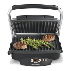 HamiltonBeach - Steak Lovers Indoor Grill - Sears meat at 500 degree F in flavor and grills to perfection. Optional searing function is great for steak and burger, just press the sear button. Grills most meals in under 10 minutes. 100 sq.in. nonstick surface. Fat drains into removable, dishwasher safe drip tray. Voltage: 1500 watts. Warranty: One year limitedThe Steak Lover's Indoor Grill quickly ramps up to a high heat thats ideal for searing in juices and flavor, then cools down to the proper grilling temperature to finish cooking. You end up with tender results in every bite, plus the skill you need to grill perfectly every time. With the touch of a button, it sears meat to lock in flavor and juices for perfect results every time.