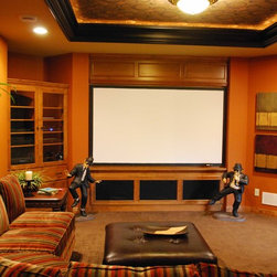 Home Theater - Home theater projector, projection screen and surround sound system.