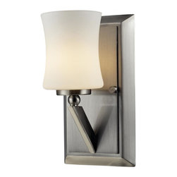 One Light Brushed Nickel Matte Opal Glass Bathroom Sconce - This one light vanity uses an exquisitely designed, angled brushed nickel arm to hold a uniquely shaped, warm glowing matte opal shade.