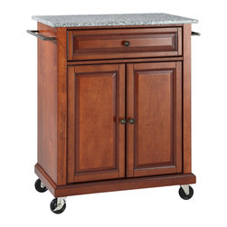 Crosley - Solid Granite Top Portable Kitchen Cart/Island in Classic Cherry Finish - Constructed of solid hardwood and wood veneers, this kitchen island is designed for longevity. The beautiful raised panel doors and drawer front provide the ultimate in style to dress up your kitchen. The deep drawer are great for anything from utensils to storage containers. Behind the two doors, you will find an adjustable shelf and an abundance of storage space for things that you prefer to be out of sight. Style, function, and quality make this kitchen island a wise addition to your home.