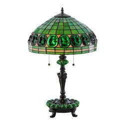 """Meyda - 25""""H Turtleback Green Accent Base Table Lamp - Inspired by the tiffany studios masterpiece, thisclassic reproduction pendant combines fine artistry,superior craftsmanship and beautiful ambient lighting.originally created for louis comfort tiffany's livingroom in his famed country residence called laureltonhall on long island outside New York city, this uniquependantexudes a simple, strong masculine energy. Astunning, belted band reveals inset borders of ovalshaped emerald glass turtleback accents that arehighlighted on a geometric background of cream withsunburst colors. This stunning art glass shade iscomplemented with a decorative mahogany bronzefinished, footed base with matching green accents. Bulb type: med bulb quantity: 2 bulb wattage: 60"""