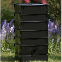 "The Worm Factory® 5-Tray Recycled Plastic Worm Composter - Black - The Worm Factory 5-Tray Recycled Plastic Worm Composter - Black is like a capsule hotel in Tokyo … except the guests are 6 000 worms and it goes in your backyard. Made from 100% recycled plastic this composter allows worms to happily nosh 24/7 on your kitchen waste and whatnot providing you rich organic material. Odorless well-organized green … and best of all the worms will eat the kitchen waste you leave behind. Even your junk mail! What is The Worm Factory and how does it work?Unique and ingenious the Worm Factory is a composter comprised of stacking trays in which worms eat your scraps and leave behind rich organic material. Fill each tray with scraps like vegetables fruits egg shells coffee grounds paper and junk mail and in turn you'll get nutrient-rich compost for your garden. Worm castings are known to be the very best compost available. Your plants will thrive with this all-natural compost. Worms start in the bottom tray and work upward as they break down the waste. The worms leave behind the stuff and you don't even have to sort through the wiggly friends at all as they're already on the next tray up. Plus nutrient-rich moisture is captured in the collection tray and can be used as liquid fertilizer known as """"worm tea."""" What are the benefits of using The Worm Factory? It's Compact: It stacks instead of spreading out so if you're short on space no worries. The Worm Factory takes up a minimal amount of space. Odorless: With a smart ventilation lid and specific suggestions in the instruction manual The Worm Factory remains odorless as it works tirelessly to create rich organic material. So breathe easy! Easy to Manage: The trays are lightweight and easy to stack and move and the accompanying instruction manual is chock full of suggestions to make composting easy and seamless. Saves Time: Forget running out to your composter to tumble and turn it! Let the worms do the work for you. They'll happily munch their way through your scraps and even junk mail and you reap the benefits of what they leave behind. They don't stop either so the rate of compost is faster. Those babies can nosh up to 8 pounds of food per week providing you a whole tray of nutrient-rich castings every month. That's efficiency."