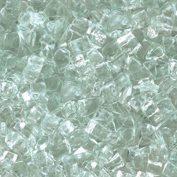"American Fireglass Clear | 1/4-in Fire Glass | 10 lbs - AFF-CLR-10 American Fireglass 10 lbs 1/4"" Accent Gems - Clear Crystal Brilliance accent gems American Fireglass 1/4 Inch Clear fire glass is available in our Classic Collection. It is an excellent color choice if you want the elegant look of fire burning through a bed of sparkling gemsin your fireplace. Clear is also a great addition to an outdoor fire pit because it offers the illusion that the fire is burning up through water. Clear fireglass is the most common color customer's purchase to use as filler and top with a color from our Premium Collection.  Specifications:"