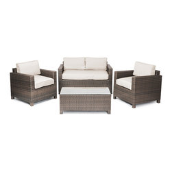 "Reef Rattan - Reef Rattan 4 Piece Conversation Set - Chocolate Rattan / Beige Cushions - Reef Rattan 4 Piece Conversation Set - Chocolate Rattan / Beige Cushions. This patio set is made from all-weather resin wicker and produced to fulfill your needs for high quality. The resin wicker in this patio set won't fade, shrink, lose its strength, or snap. UV resistant and water resistant, this patio set is durable and easy to maintain. A rust-free powder-coated aluminum frame provides strength to withstand years of use. Sunbrella fabrics on patio furniture lends you the sophistication of a five star hotel, right in your outdoor living space, featuring industry leading Sunbrella fabrics. Designed to reflect that ultra-chic look, and with superior resistance to the elements in a variety of climates, the series stands for comfort, class, and constancy. Recreating the poolside high end feel of an upmarket hotel for outdoor living in a residence or commercial space is easy with this patio furniture. After all, you want a set of patio furniture that's going to look great, and do so for the long-term. The canvas-like fabrics which are designed by Sunbrella utilize the latest synthetic fiber technology are engineered to resist stains and UV fading. This is patio furniture that is made to endure, along with the classic look they represent. When you're creating a comfortable and stylish outdoor room, you're looking for the best quality at a price that makes sense. Resin wicker looks like natural wicker but is made of synthetic polyethylene fiber. Resin wicker is durable & easy to maintain and resistant against the elements. UV Resistant Wicker. Welded aluminum frame is nearly in-destructible and rust free. Stain resistant sunbrella cushions are double-stitched for strength and are fully machine washable. Removable covers made with commercial grade zippers. Tables include tempered glass top. 5 year warranty on this product. Two Seat Sofa: W 57"" D 29"" H 27"", Chairs (2): W 29"" D 29"" H 27"", Coffee Table: W 40"" D 20"" H 16"""