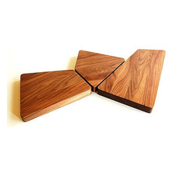 Skewed Serving Boards - Forget round and square serving trays! Our skewed serving trays are as visually compelling as they are functional. Make a statement with your meats and cheeses, cheese and crackers, and nuts and fruits at your dinner party. We machine our trays from 8/4 solid walnut then hand sand and finish with a food safe 'salad bowl' oil. Available at most home stores, simply reapply the oil when loving use has dulled the finish to keep your cutting and serving boards as beautiful as the day you welcomed them to your kitchen.