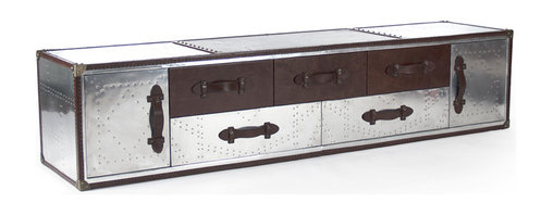 Kathy Kuo Home - Steamer Industrial Loft Oversized Metal Storage Long Cabinet - Evoking the romance of luxury travel and wanderlust, this impressive, oversized chest has ample storage space and overflowing style. With seven spacious drawers, it can be used in a hallway for bedding or a bedroom for off-season clothing. Polished silver metal, embossed with a punched pattern contrasts with rich brown leather for an eclectic, go-anywhere piece.