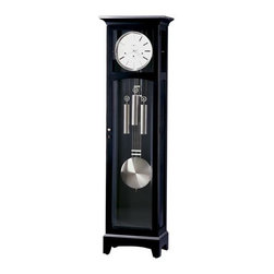 "Howard Miller - Howard Miller - Urban Floor Clock III Floor C - Time stands tall in this contemporarily constructed Kleininger Floor Clock defined by captivating black satin finish and nickel accents, a gorgeous piece to invigorate your home's d̩cor. * This unique floor clock boasts simple, contemporary elegance. . Simple lines best describe this case, which offers a flat-top pediment with a nickel finished molding. . A crisp, white dial features a nickel finished bezel and simply-styled hour markers and hands. . Upper and lower door glass is beveled. . The nickel accents continue on the doorknob, weights, pendulum and the moldings at the base. . Cable-driven, Westminster chime Kieninger movement with automatic nighttime chime shut-off option. . Finished in Black Satin on select materials, hardwoods and veneers. . Adjustable levelers under each corner provide stability on uneven and carpeted floors. . Automatic nighttime chime shut-off option. . Locking door for added security. . You will receive a free heirloom plate, engraved with name and date, by returning the enclosed request card to Howard Miller.. Manufacturer's 2 Year Warranty. 78 1/2""(199 cm) x 22""(56 cm) W x 14""(36 cm) D"
