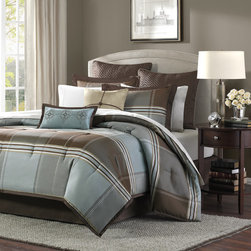 """Madison Park - Lincoln Square Comforter Set - For an updated classic color block bedding, you can't go wrong with Lincoln Square. The color blocks are in shades of brown, grey and light blue. The woven comforter offers unique weave details that add texture and dimension to the design of this comforter. The reverse is a solid warm brown. Features: -Set included 1 comforter, 2 king shams, bedskirt, 2 euro shams and 2 decorative pillows. -Color: Blue / brown. -Material: Polyester jacquard. -Brushed polyester back on comforter and shams. -Detailed decorative pillows. -Machine-washable. -Dimensions: 90""""-104"""" Height x 90""""-92"""" Width."""