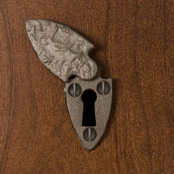Cast Iron Spear Keyhole Escutcheon - The Spear Keyhole Escutcheon features a swinging cover and brings authentic charm to your home. Made of durable iron, this keyhole cover is perfect for dressers, desks and doors.