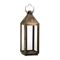 "Fez Star Punched Metal Lantern, Medium, Bronze finish - Hung from branches or garden stakes, multiples of our lanterns mimic a starry sky. Small: 4.75"" wide x 4.5"" deep x 13"" high Medium:7.5"" wide x 7"" deep x 22"" high Large: 10"" wide x 9.5"" deep x 30"" high Made of stainless steel with a bronze finish. Glass panes."