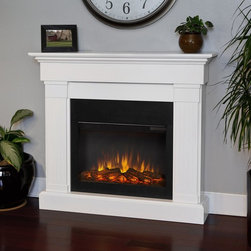 Real Flame - Real Flame Crawford Slim Line Electric Fireplace - White - 8020E-W - Shop for Fire Places Wood Stoves and Hardware from Hayneedle.com! The comforts of home are incomplete without a Real Flame Crawford Slim Line Electric Fireplace - White. This electric fireplace glows with an ultra-bright Vivid Flame LED light adjustable to five different brightness settings. The firebox remains clean safe and cool to the touch. The mantle itself made in a classical trim design with fluted columns is finished in contemporary white. Easily added to any room of your home it anchors to the wall and conveniently plugs into any standard outlet. It also includes a remote control programmable thermostat and timer for the ideal level of comfort every time.About Real FlameReal Flame is the original premium gel fuel designed for use with ventless gel fireplaces and accessories. For more than 25 years Real Flame has been the leading alcohol-based gel fuel on the market. Real Flame gel is an environmentally friendly non-toxic clean-burning gel that doesn't leave any soot smoke or ashes behind - so there's no messy cleanup. Best of all Real Flame creates a robust bright yellow orange and red flame that crackles just like a log fire. Made in the U.S.A.Real Flame is made from pure premium-grade isopropyl alcohol and thickeners to enhance stability. Real Flame is the safest most viscous (thick) gel fuel available on the market. It is not liquid and will not break down separate or liquefy as quickly as other brands. To maintain the integrity and stability of Real Flame all Real Flame gel cans are specially treated to prevent rusting on the inside. Environmentally FriendlyReal Flame is a safe clean-burning gel that is regularly tested by numerous independent labs. Air-quality results while burning Real Flame gel fuel fall well below the standards established by the Occupational Safety and Health Administration (O.S.H.A.) and the Environmental Protection Agency (E.P.A.). Each batch of Real Flame gel fuel production is closely monitored to ensure the highest quality. EfficiencyEach can of Real Flame gel fuel is designed to burn for up to 2.5 to 3 hours. If you wish to create a fire for a shorter period simply extinguish the flame and re-cap the can. Reuse any remaining gel fuel for your next fire. For each fire you may use one to three cans of gel fuel at a time depending on the size of fire you wish to create. When compared to cartridge-style cans one can of Real Flame gel fuel is available at a fraction of the cost. Growing PopularityMillions of consumers can't be wrong. Loyal customers have made Real Flame the leading gel fuel on market today. Don't be fooled by unscientific consumer polls. Real Flame is the original and best-selling gel fuel available and has been on the market the longest. Never settle for any other gel fuel in your Real Flame fireplace or accessories.