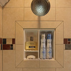 Recessed Bathroom Tile Niches - Recessed shower niche with bull nose tile overlay, centered under shower head at eye level with centered accent strip.