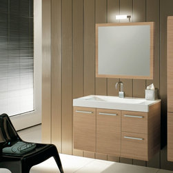 Iotti - 38 Inch Bathroom Vanity Set - Linear Collection LE2: A contemporary design, excellent Italian craftsmanship and long-lasting performance give this vanity set from Italy all the good things you need for your bathroom. You can choose Glossy White, Wenge or Natural Oak for your waterproof finish. The framed mirror is scratch and corrosion resistant. There's plenty of storage inside the doors and drawers that all have soft closing mechanisms for long life. Plus, you get five inches of shelf space on the fitted solid resin sink. Comes complete with vanity light. Set Includes: . Vanity Cabinet (2 doors, 2 drawers). Fitted ceramic sink (38.3 inch x 17.3 inch ). Mirror (30.9 inch x 27.7 inch ). Vanity Light. Vanity Set Features:. Vanity cabinet made of engineered wood. Cabinet features waterproof panels. Available in Natural Oak (as shown), Wenge, Glossy White. Cabinet features 2 doors, 2 soft-closing drawers. Faucet not included. Perfect for modern bathrooms. Made and designed in Italy. Includes manufacturer 5 year warranty.