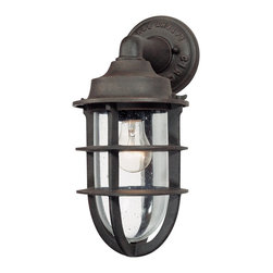 "Troy - Wilmington Collection 14 1/2"" High Outdoor Wall Light - The Wilmington outdoor collection from Troy Lighting illuminates your exterior with nautical style. This wall light design recalls boat light aesthetics with authentic foundry embossed backplate. Crafted from cast aluminum and presented in a nautical rust finish. Clear seeded glass adds extra appeal. An attractive design for lighting your outdoor spaces. Cast aluminum construction. Nautical rust finish. Clear seeded glass. Takes one 100 watt bulb (not included). 14 1/2"" high. 6 3/4"" wide. Extends 8 1/4"" from the wall. 2 1/2"" from mounting point to top.  Cast aluminum construction.   Nautical rust finish.   Clear seeded glass.   Takes one 100 watt bulb (not included).   14 1/2"" high.   6 3/4"" wide.   Extends 8 1/4"" from the wall.   2 1/2"" from mounting point to top."