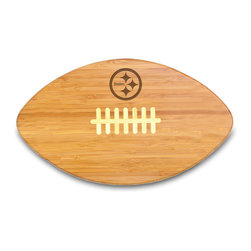 """Picnic Time - Pittsburgh Steelers Touchdown Pro Cutting Board in Natural Wood - The Touchdown! cutting board is a 15"""" x 8.75"""" x 0.75"""" board made of eco-friendly bamboo with a standard football design, with 123 square inches of cutting surface. It can be used as a cutting board or serving tray, or use both sides of the board, one for cutting and the other for serving. The backside of the board is solid dark bamboo. Go long...for the Touchdown! Decoration: Engraved"""