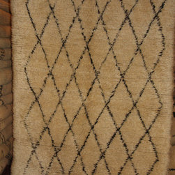 "Moroccan Imported Rugs - Beni Ourain rugs are made of plush sheep wool. They originate from the Atlas Mountains from the Berber tribes. Introduced to the West by Frank Lloyd Wright and coined ""the white giants""."