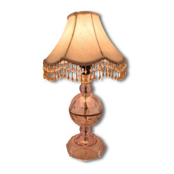 Zeckos - Faceted Crystal Clear Table Lamp with Beaded Fringe Shade - This pretty lamp adds an elegant accent to your home. The clear acrylic base is faceted, giving it the look of crystal, and it is topped off with a fabric shade featuring scalloped edges with beaded fringe. The lamp is 22 inches tall, the shade measures 12 inches in diameter, and the lamp uses a 40 watt (max) type A bulb (not included). It has a 5 foot long black power cord with a rocker on/off switch. This lamp is a lovely addition to tables in entryways, nightstands in bedrooms, and end tables in formal living rooms.