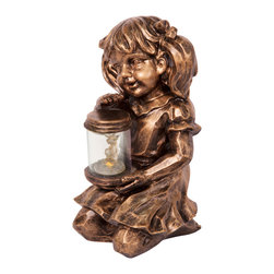 "Enchante Accessories Inc - Firefly Catcher Sculpture with Solar Powered LED Light (Sitting Girl) - Little girl sculpture with a solar powered LED light Cast resin construction with an antique bronze finishSolar panel on the back with a built-in dusk till dawn sensor Can be used indoors or outdoors Measures 14.5 in. x 11.2 in. x 8.6 in. Add a charming touch to your garden or outdoor space with this adorable solar powered little boy LED light sculpture.  The Sitting Girl Sculpture With Solar Powered LED Light is constructed from cast resin and features a two-tone bronze finish that gives it a weathered, antique look.  The little boy sits cross-legged and holds a small jar of flowers and fire flies in his hands, giving him the sweet and innocent look of a child enjoying the garden and the beauty of nature around him.  Doing double duty as a decorative piece and a functional solar powered light, this sculpture will look right at home on a front porch, beside a stone pathway, or placed inside a flower bed. With a smart design that requires no electrical wiring, this LED light features a dusk till dawn sensor and a small solar panel on the back of the boy""s shirt that powers the light from the sun.  While it stores solar power throughout the day, this sculpture is designed with a built-in sensor that automatically turns the light on at dusk and off at dawn.  The LED light sets off a nice illuminating glow that can act as a safety light on any walkway or patio.  The sculpture itself is incredibly detailed and has a realistic look that highlights everything from the texture of the boy""s hair to the wrinkles in his shirt to his little fingernails.  The clear cylinder of the jar allows the light to shine through while the flower shaped LED light in the center adds another dimension of beauty and natural charm.   This LED light can also be used as a decorative piece inside your home or on an enclosed patio.  The durable design looks as great on an indoor shelf as it does in a garden setting and can be paired with a little girl sculpture to create a matching set to flank a walkway or a set of outdoor stairs. U.L. Listed."