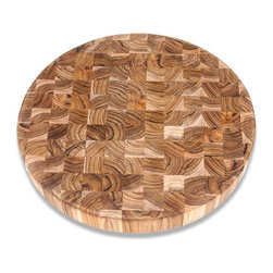 "Bambeco Teak Circle Cutting Board - This large, end-grain Teak Circle Cutting Board is a stunning addition to any counter or tabletop. Even when not in use, it can be left on display to accent a vase, clocked or decorative piece. These beautiful pieces are crafted from conflict-free, FSC-certified organic teak grown on a sustainably-managed, renewable plantation located on reclaimed ranch lands. Teak has long been prized in the marine industry, and those same features make it ideal for cutting boards. The high levels of natural oils help repel moisture and prevent the wood from warping or drying out.  Care: Hand wash with mild soap and water, allow to dry thoroughly. Periodically treat with a light, food-grade oil to preserve the wood's natural beauty and prolong its life. Dimensions: 18"" diam. x 2""H"