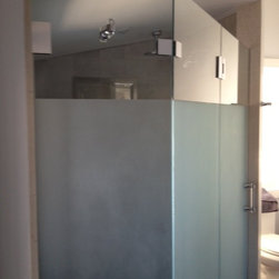 """Frameless Shower Enclosure - Fully frameless shower enclosure.  Client wished to have glass sandblasted 60"""" up from bottom to allow for privacy.  Top portion was left clear to allow light to enter.  All hardware is polished chrome.  Fittings by portals. Handle and robe hook feature crystal elements."""