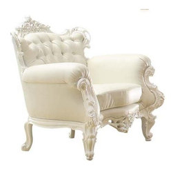 Diva Rocker Glam - Roll Arm Chair - Look who's rocking the rococo. This is a mighty meringue of a chair featuring raised resin detailing on the back, arms and feet. The wooden frame is covered in thick foam and eco-leather with button tufting on the back so it's ready for lounging and lighting up your room.