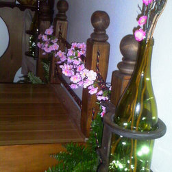 Gresham, Oregon Rental House - Also at the end of the bed I built a decorative steps and platform along with a faux railing with bottle lights. This makes it alot easier to get in their three foot tall bed. In the evening its all lit up to guide your way to bed.