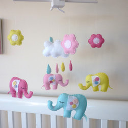 Baby Elephants, Happy Raincloud and Flowers Mobile by Maisie-Moo - Elephants are a darling nursery motif, and I love the colors used in this sweet mobile.
